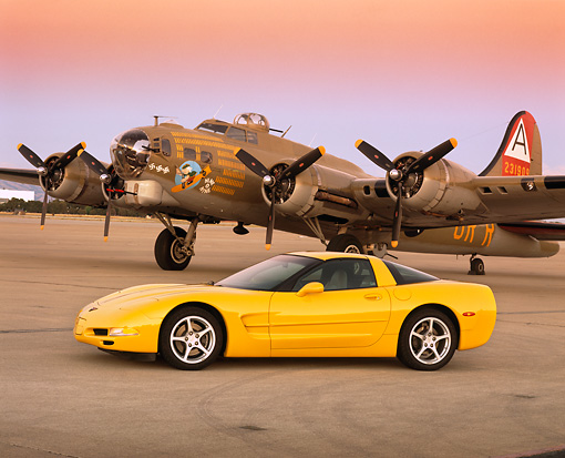 VET 01 RK0442 02 © Kimball Stock 2000 Chevrolet Corvette C5 Yellow 3/4 Front View On Pavement By Airplane Filtered