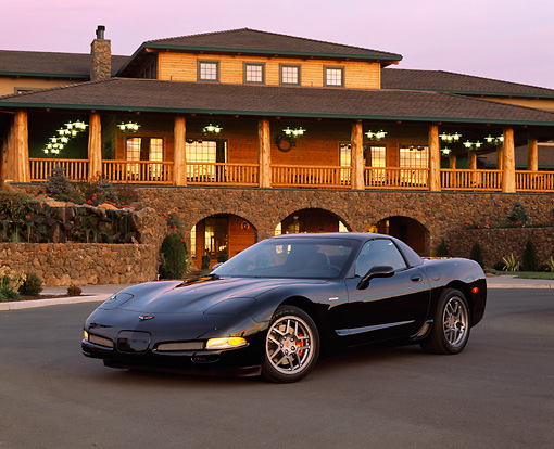 VET 01 RK0494 03 © Kimball Stock 2001 Chevrolet Corvette Z06 Black 3/4 Front View By Building At Dusk