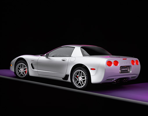 VET 01 RK0511 01 © Kimball Stock 2001 Chevrolet Corvette Z06 Silver 3/4 Rear View On Purple Floor Gray Line Studio