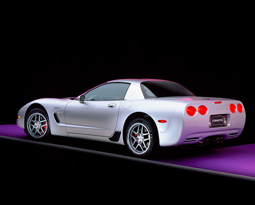 VET 01 RK0511 06 © Kimball Stock 2001 Chevrolet Corvette Z06 Silver 3/4 Rear View On Purple Floor Gray Line Studio