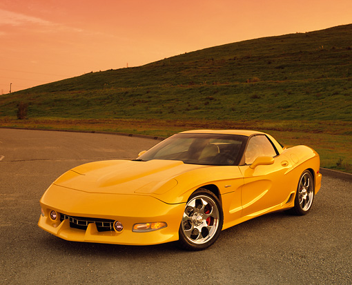 VET 01 RK0544 02 © Kimball Stock 2002 Chevrolet Corvette Z06 Avelate Yellow 3/4 Front View On Pavement