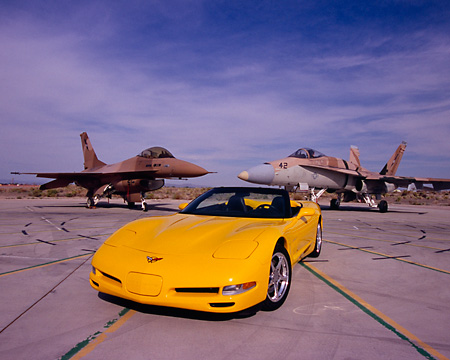 VET 01 RK0662 07 © Kimball Stock 2001 Chevrolet Corvette Roadster Yellow By Two Jet Fighter Airplanes