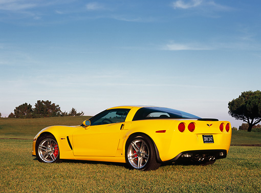 VET 01 RK0727 02 © Kimball Stock 2006 Chevrolet Corvette Z06 Yellow Low 3/4 Rear View On Grass