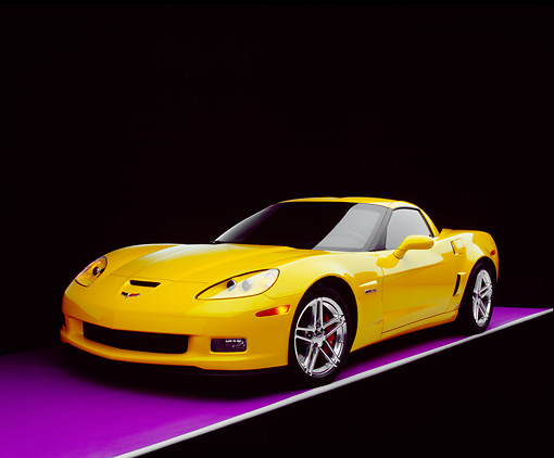 VET 01 RK0733 03 © Kimball Stock 2006 Chevrolet Corvette Z06 Yellow 3/4 Front View On Purple Floor Studio