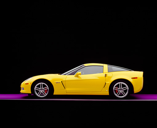 VET 01 RK0736 09 © Kimball Stock 2006 Chevrolet, Corvette, Z06, Yellow Profile View On Purple Floor Studio