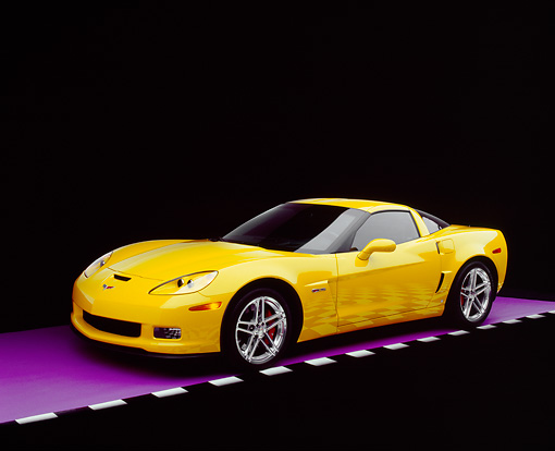 VET 01 RK0737 08 © Kimball Stock 2006 Chevrolet, Corvette, Z06, Yellow 3/4 Side View On Purple Floor Checkered Line Studio