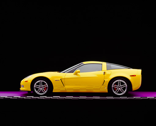 VET 01 RK0738 07 © Kimball Stock 2006 Chevrolet, Corvette, Z06, Yellow Profile View On Purple Floor Checkered Line Studio