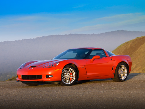 VET 01 RK0764 01 © Kimball Stock 2007 Chevrolet Corvette Z06 Red  3/4 Side View On Pavement