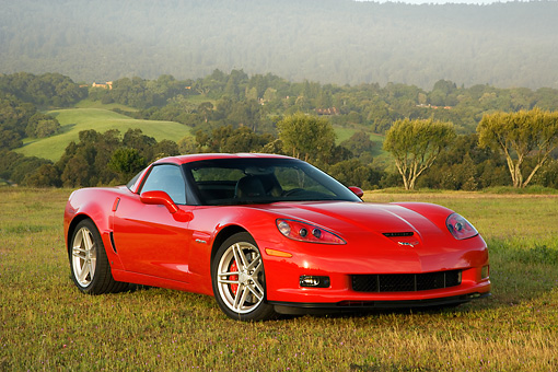 VET 01 RK0767 01 © Kimball Stock 2007 Chevrolet Corvette Z06 Red  3/4 Front View On Dirt
