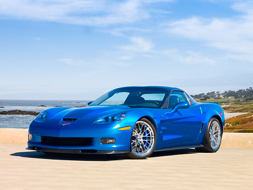 VET 01 RK0852 01 © Kimball Stock 2009 Chevrolet Corvette ZR1 Coupe Blue 3/4 Front View On Pavement Blue Sky