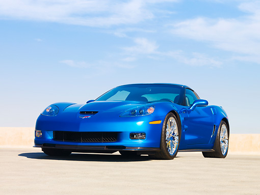 VET 01 RK0859 01 © Kimball Stock 2009 Chevrolet Corvette ZR1 Coupe Blue 3/4 Front View On Pavement Blue Sky