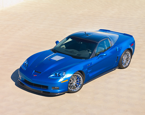 VET 01 RK0860 01 © Kimball Stock 2009 Chevrolet Corvette ZR1 Coupe Blue 3/4 Front View On Pavement Blue Sky