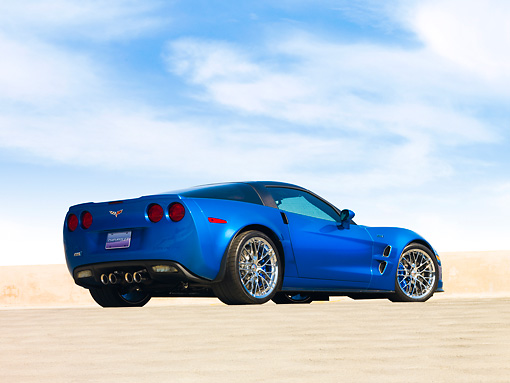 VET 01 RK0861 01 © Kimball Stock 2009 Chevrolet Corvette ZR1 Coupe Blue 3/4 Rear View On Pavement Blue Sky