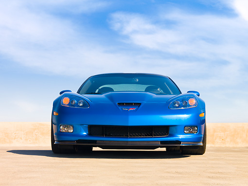 VET 01 RK0862 01 © Kimball Stock 2009 Chevrolet Corvette ZR1 Coupe Blue Head On View On Pavement Blue Sky