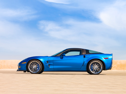 VET 01 RK0864 01 © Kimball Stock 2009 Chevrolet Corvette ZR1 Coupe Blue Profile View On Pavement Blue Sky