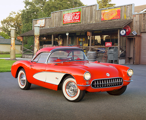 VET 02 RK0359 01 © Kimball Stock 1956 Chevrolet Corvette Red And White 3/4 Front View On Pavement By General Store