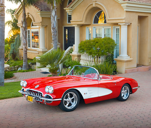 VET 02 RK0360 01 © Kimball Stock 1959 Chevrolet Corvette Red And White 3/4 Front View On Brick By House