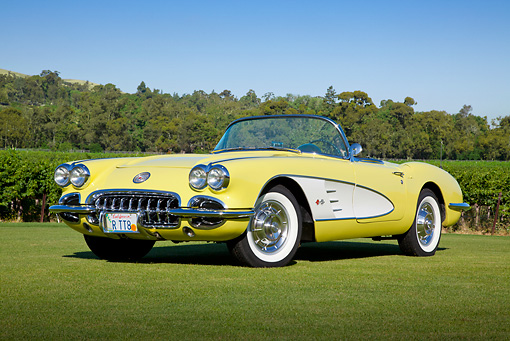 VET 02 RK0378 01 © Kimball Stock 1958 Chevrolet Corvette Convertible Panama Yellow And White 3/4 Front View On Grass By Trees