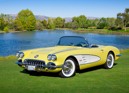 VET 02 RK0379 01 © Kimball Stock 1958 Chevrolet Corvette Convertible Panama Yellow And White 3/4 Front View On Grass By Pond
