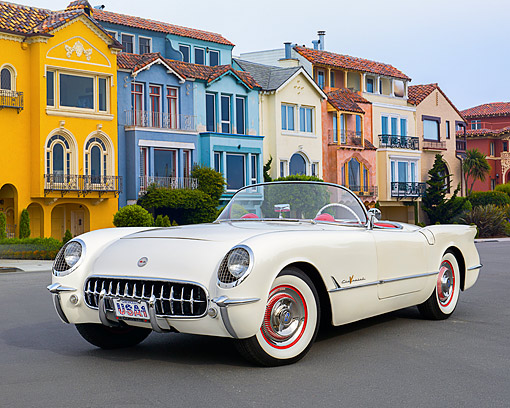 VET 02 RK0397 01 © Kimball Stock 1955 Chevrolet Corvette Polo White 3/4 Front View On Pavement By Colorful Houses