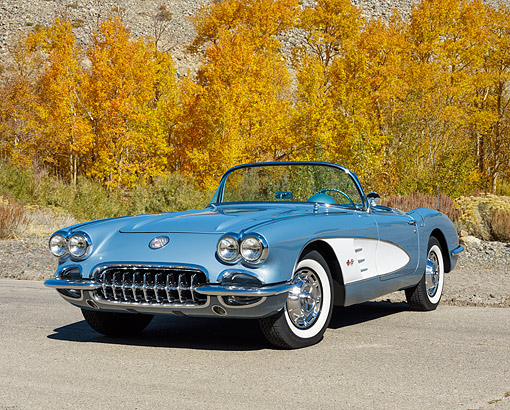 VET 02 RK0399 01 © Kimball Stock 1959 Chevrolet Corvette Frost Convertible Blue With White Cove 3/4 Front View On Pavement By Fence And Trees