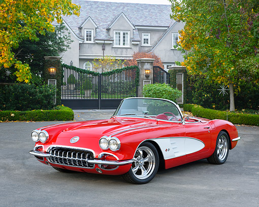 VET 02 RK0404 01 © Kimball Stock 1959 Chevrolet Corvette Convertible Red 3/4 Front View On Pavement By Mansion