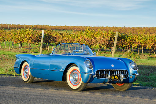 VET 02 RK0406 01 © Kimball Stock 1955 Chevrolet Corvette Roadster Blue 3/4 Front View On Road By Vineyard
