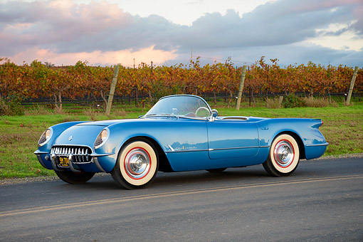 VET 02 RK0407 01 © Kimball Stock 1955 Chevrolet Corvette Roadster Blue 3/4 Front View On Road By Vineyard
