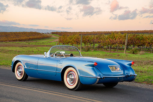 VET 02 RK0409 01 © Kimball Stock 1955 Chevrolet Corvette Roadster Blue 3/4 Rear View On Road By Vineyard
