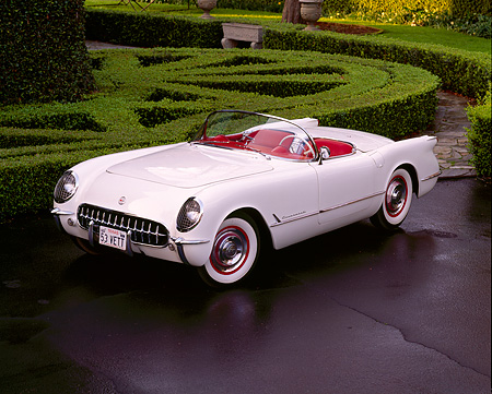 VET 02 RK0026 03 © Kimball Stock 1953 Chevrolet Corvette Convertible White Overhead Front 3/4 On Wet Pavement By Designed Bushes