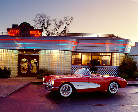 VET 02 RK0056 12 © Kimball Stock 1957 Chevrolet Corvette Convertible Red And White Side 3/4 View In Front Of Diner