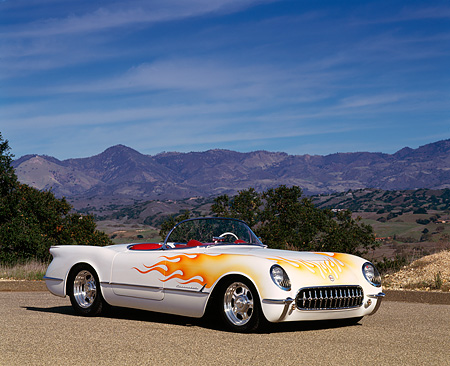 VET 02 RK0070 05 © Kimball Stock 1953 Chevrolet Corvette Convertible White With Flames 3/4 Front On Pavement Trees Mountains