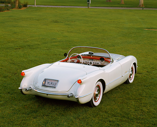 VET 02 RK0094 04 © Kimball Stock 1955 Chevrolet Corvette Convertible White 3/4 Rear View On Grass