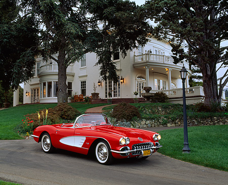 VET 02 RK0178 02 © Kimball Stock 1959 Chevrolet Corvette Fuel Injected Roadster Red White Cove 3/4 Side By House And Trees