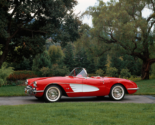 VET 02 RK0182 01 © Kimball Stock 1959 Chevrolet Corvette Fuel Injected Roadster Red 3/4 Side View On Pavement