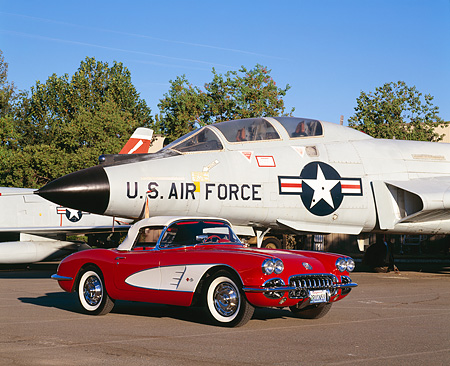 VET 02 RK0250 02 © Kimball Stock 1959 Chevrolet Corvette Convertible Red And White 3/4 Front View On Pavement By Military Airplanes