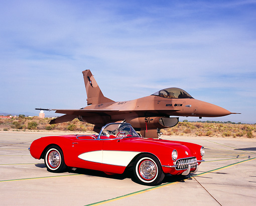 VET 02 RK0284 02 © Kimball Stock 1957 Chevrolet Corvette Convertible Red White Cove 3/4 Front View On Pavement By Fighter Jet