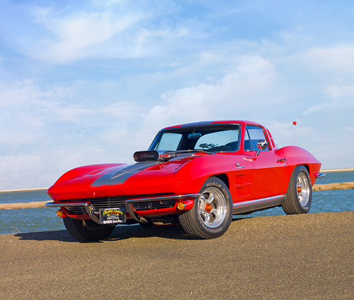 VET 03 RK0645 01 © Kimball Stock 1964 Chevrolet Corvette Stingray Red With Silver Stripe 3/4 Front View On Pavement By Water