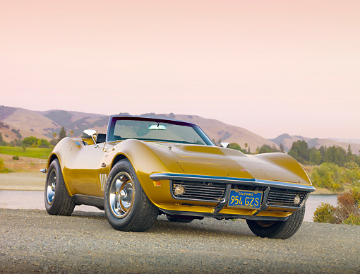 VET 03 RK0657 01 © Kimball Stock 1969 Chevrolet Corvette 427 Convertible Gold 3/4 Front View On Pavement By Lake