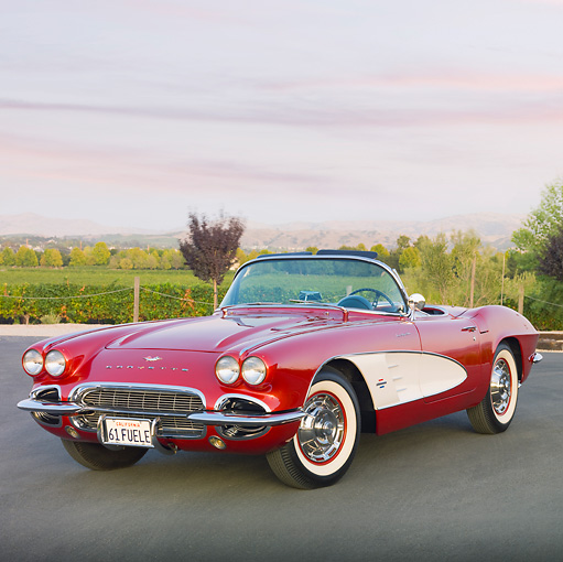 VET 03 RK0667 01 © Kimball Stock 1961 Chevrolet Corvette Convertible Maroon And White 3/4 Front View On Pavement
