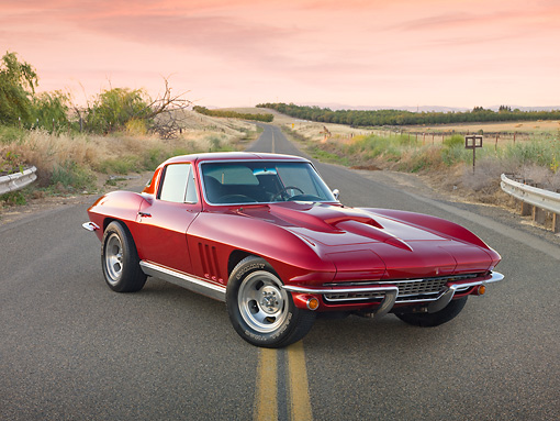 VET 03 RK0685 01 © Kimball Stock 1966 Chevrolet Corvette Red 3/4 Front View On Road By Dry Grass