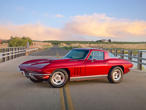VET 03 RK0686 01 © Kimball Stock 1966 Chevrolet Corvette Red 3/4 Front View On Road By Dry Grass And Pond