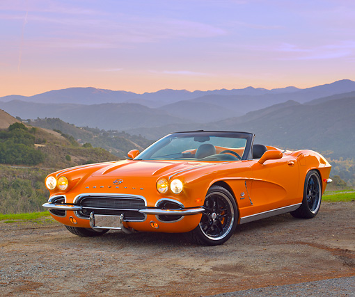 VET 03 RK0695 01 © Kimball Stock 1962 Chevrolet Corvette Convertible Orange 3/4 Front View On Pavement By Hills