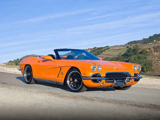 VET 03 RK0698 01 © Kimball Stock 1962 Chevrolet Corvette Convertible Orange 3/4 Front View On Pavement By Hills