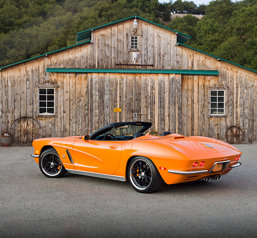 VET 03 RK0704 01 © Kimball Stock 1962 Chevrolet Corvette Convertible Orange 3/4 Rear View On Pavement By Old Barn