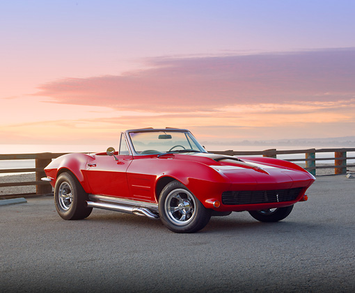 VET 03 RK0714 01 © Kimball Stock 1964 Chevrolet Corvette Convertible Red 3/4 Front View On Pavement By Beach