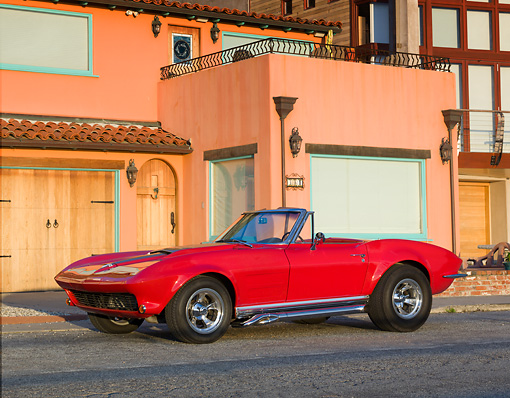VET 03 RK0720 01 © Kimball Stock 1964 Chevrolet Corvette Convertible Red 3/4 Side View On Pavement By House