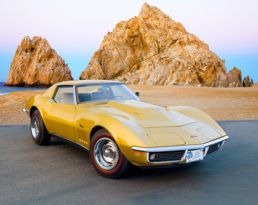 VET 03 RK0728 01 © Kimball Stock 1969 Chevrolet Corvette L88 Gold 3/4 Front View On Pavement By Red Rock And Ocean