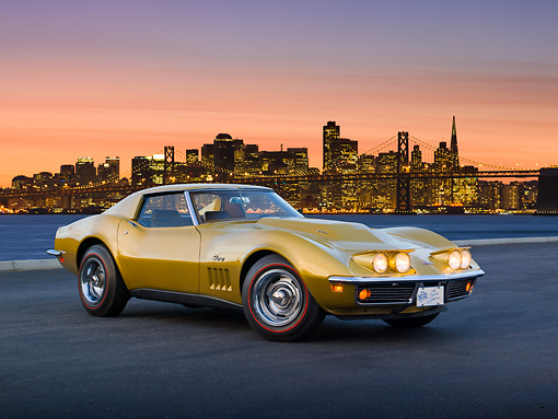 VET 03 RK0729 01 © Kimball Stock 1969 Chevrolet Corvette L88 Gold 3/4 Front View On Pavement By City Skyline At Sunset