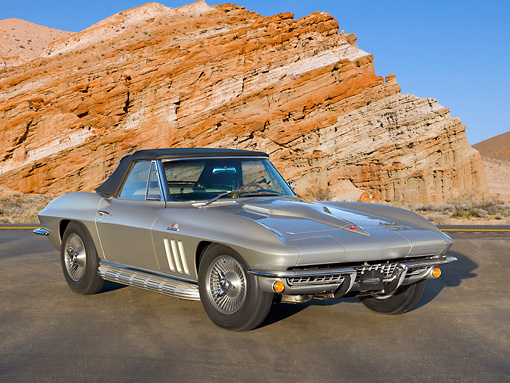 VET 03 RK0731 01 © Kimball Stock 1966 Chevrolet Corvette L72 427/425HP Roadster Gray 3/4 Front View On Pavement By Red Rock